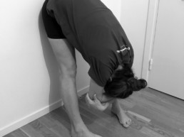 Uttanasana wall support